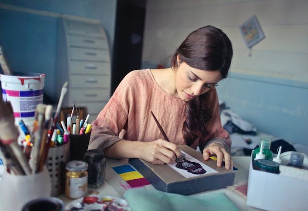Art studio owner drawing picture
