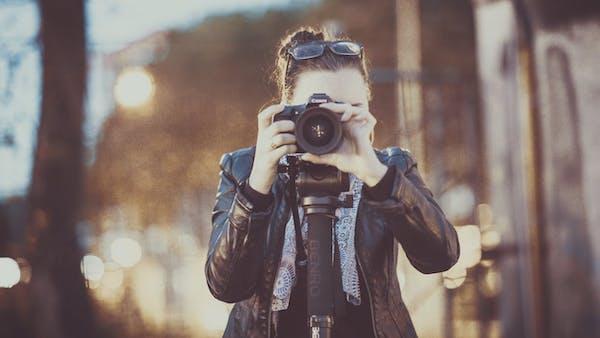 Photographer posing with camera
